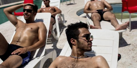 "A group of young men takes sun bath in a private complex in Royan (Northern Iran). Although Islamic morals are taken laxly in private areas in Northern Iran, gender segregation in the swimming pool is still strictly controlled. Photo: Kaveh Rostamkhani  Handout: Im Rahmen der Berichterstattung zur Ausstellung ""Iran: Generation Post-Revolution"" im Juli 2016 in Muenchen, duerfen maximal zwei Handout-Fotos honorarfrei veroeffentlicht werden. Veröffentlichung außerhalb des Kontexts des Foto-Essays ist untersagt."